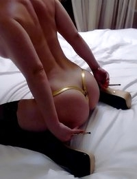 Angel Jones takes off her golden satin robe