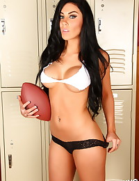 Busty Alluring Vixen Danielle scores a touch down with her skimpy ripped top and panties