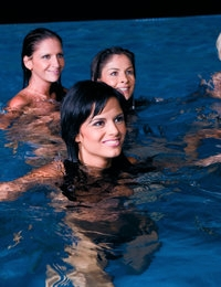 Eight babes in heat dive in the swimming pool to have fun