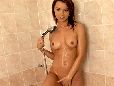 Busty Nubile Explores Her Tight Body