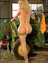 Caution! Tractor girl at work. Yes watch out for this one or she will mow you over. Here's my last ever set of photos of the awesome Ahmo Hight. I forgot I had this one until just the other day when searching through my archives. It's Ahmo looking her best, although this set was taken during her strictly glamour modeling days. Nothing showing here as she does in some of my later sets that I personally took of her; but if you are collecting Ahmo sets, this is one you don't have. It's full nude but no open legs. Ahmo Hight is one of a kind. She's truely one of the very few models who originally defined the term 'Fitness Model' in the 90's. She's a legend.