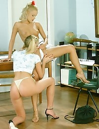 Two hot blondes licking sweet pussies each other  in a classroom