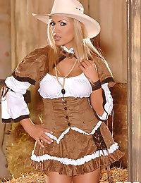 Blonde Cowgirl Stripteases