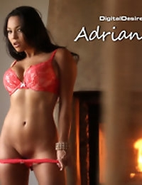 Adrianna Luna undresses by the fire
