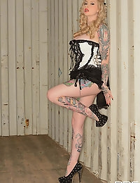 Tattooed Pinup Girl Strips