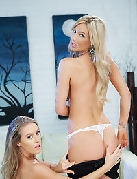 Nicole Aniston and Whitney Marie enjoy a bit of blonde big boobie lesbian action with each other.
