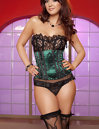 Veronica Ricci slides out of her corset to reveal her perfect body.