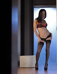 Selma Sins struts her stuff in sheer stockings and high heels before filling her horny hole with her talented fingers