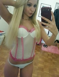 Skanky chick teasing and posing in lingerie