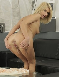 Kinky blonde pisses on her own pretty feet