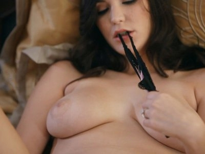 Buxom Holly Michaels rocks her horny big breasted body as she finger fucks her soft dripping pussy until she is moaning