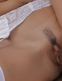 Watch hot blonde Felicity Jade dress up in a white corset and sheer stockings and indulge her creamy wet pussy outside