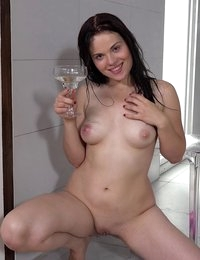 Dark haired babe pisses into a wine glass