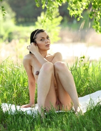 Graceful model with flexible body Macy looks elegant posing outdoors