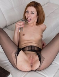 Gorgeous redhead toys her pussy and ass