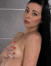Pretty dark haired girl gets covered in cum