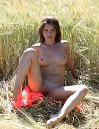 Busty sweetheart Jasmin relaxes outdoors showing off her nude body