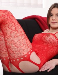 Pretty brunette shows her pussy in bodystocking