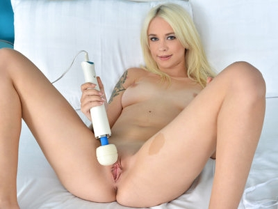 Luscious blonde uses a high voltage wand to reach orgasm