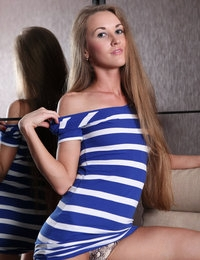 Young long-haired beauty Larisa shows her good figure and tight ass