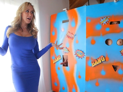 Brandi Love watches while her daughter Rebel Lynn and Rebel's boyfriend Johnny Castle work on a beanbag toss game that they are donating. The minute Brandi leaves the room, though, Rebel jumps into Johnny's arms and starts peeling off her clothes as she indulges all of the pent-up sexual energy that has been churning between them.Soon Rebel has her lips wrapped tightly around Johnny's cock as she delivers a lusty blowjob. Her deep throat enthusiasm only ratchets higher as Jonny leans forward to slap her ass. Although the couple is on the verge of taking things a step further, they are interrupted when Brandi returns unexpectedly. Even though they're hidden behind the screen of the bean bag toss, the holes line up perfectly to reveal all of their private bits.Thinking that the hidden people are her swinger friends, Brandi is happy enough to play. Within moments she has dropped to her knees sucking Johnny's cock and fondling Rebel's bald pussy and small tits. The trouble really starts when Rebel and Johnny are revealed much to Brandi's chagrin. After a moment of hesitation, Brandi announces that since they've started they may as well finish it.That kicks off a lusty threesome as Johnny and Rebel work to get Brandi out of her dress, bra, and thong. Once Brandi is nude, she and Rebel hop onto the bed side by side so that Johnny can put his hands and mouth to work working both of their needy twats into a juicy state of horniness. When Johnny switches places with them, the girls are happy to return his oral favors with a double blowjob.Seeking the ultimate satisfaction, Rebel and Brandi eventually break up their suckfest so that Rebel can plant her pussy on Johnny's mouth while Brandi sinks down for a stiffie ride. In addition to enjoying every moment of Jonny's pussy feast, Rebel can't help but lean forward to lick Brandi's clit in an effort to increase her step mom's pleasure. Things only heat up more when Brandi climbs off of Johnny's member so that Rebel can have a turn at a reverse cowgirl pussy pounding while Johnny puts his mouth to work making Brandi moan.Getting up on her hands and knees, Brandi presents her lush rump for Johnny to go to town. Meanwhile, Brandi muffles her moans of ecstasy by burying her face in Rebel's bald twat. As Rebel enjoys the way her body hums from its most recent climax, she crawls beneath Brandi to suck her step mom's clit and Jonny's balls.The trio is starting to run out of steam, but they're not quite sated yet. Rebel gets a final chance to enjoy Johnny's cock before Brandi nudges her out of the way for one last pussy pounding. Unable to hold back a moment longer, Jonny pulls out of Brandi's snatch so that he can fill Rebel's waiting mouth with cum that she can't wait to swallow and snowball with Brandi.