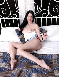 Brunette babe Felicia stripping and showing her pussy