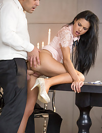 Antonio and Apolonia are playing poker, but they're also having some drinks. It doesn't take long before Antonio takes her hand and places it on his pants. At first, Apolonia pretends not to like it, but pretty soon she's all horny and giving Antonio exactly what he wants. She starts by having a good time on his member with her mouth, down on her knees getting him good and ready. Pretty soon Antonio feels like he'd like something a bit harder, so he puts her on the table, lifts her skirt, and gets to work. Apolonia loves it, and moans with delight. As the two go at it on the table beneath the chandelier, things get even more intense and they move to the couch for some fully naked banging. Apolonia is so hot and horny in this amazing video, but the real prize is the look on her face when it's all over - she certainly was glad they stopped playing poker!