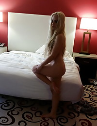 Petite blonde girlfriend strips naked as her boyfriend takes pictures secretly to share with us