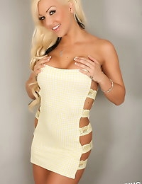 Perfect Alluring Vixen Kimmy shows off her dangerous curves in a sexy little yellow lace dress that barely can contain her huge tits photo #4