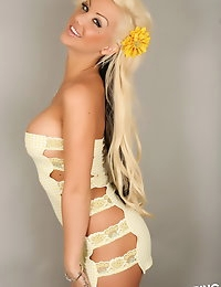 Perfect Alluring Vixen Kimmy shows off her dangerous curves in a sexy little yellow lace dress that barely can contain her huge tits photo #8