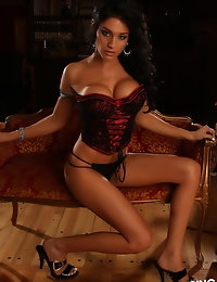 Busty Alluring Vixen Amanda can barely be contained by her sexy lace corset photo #10