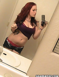 Busty girl takes mirror selfshot pictures for her boyfriend who uploaded them for us photo #1