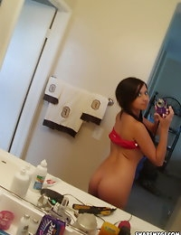 Big breasted teen takes selfshot pictures of her big juicy real tits photo #6