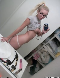 Super cute blonde teen takes selfshot pictures of her tight pussy and perfect perky tits photo #12