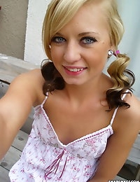 Cute blonde takes selfshot pictures of her perfectly shaven pussy with no panties on photo #1