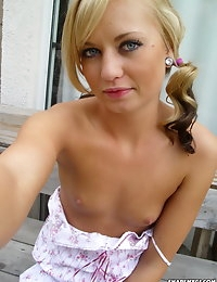 Cute blonde takes selfshot pictures of her perfectly shaven pussy with no panties on photo #10