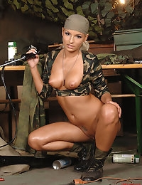 Hot military blond babe gets herself fucked by a machine photo #15