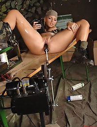 Hot military blond babe gets herself fucked by a machine photo #10