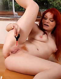Redhead Barbara's anal vibrator and piss play photo #11